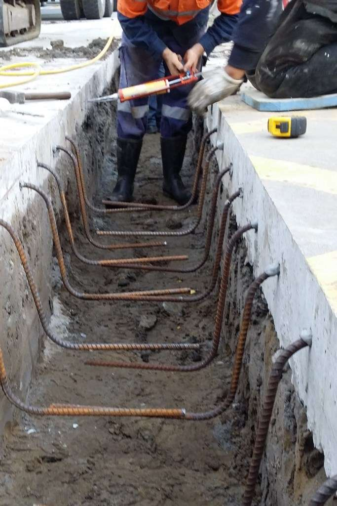 Rebar is inserted into the holes and cemented with expoxy resin