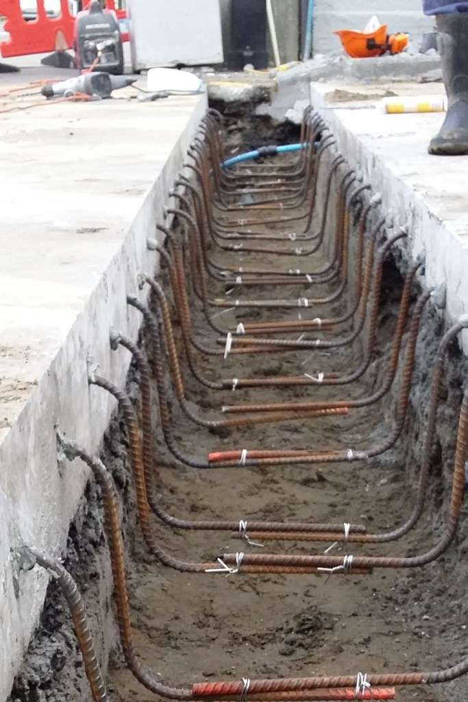 Rebar is tied to form stirrups. The bottom of the stirrups need to be about half the distance between the bottom of the channel and the trench bottom. 100mm Width, 50mm from the bottom of the channel & 200mm width, 75mm from the bottom of the channel