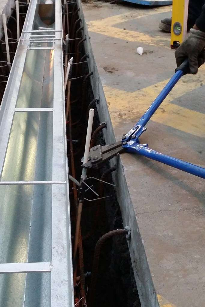 The Fibreglass rods are trimmed to below the surface