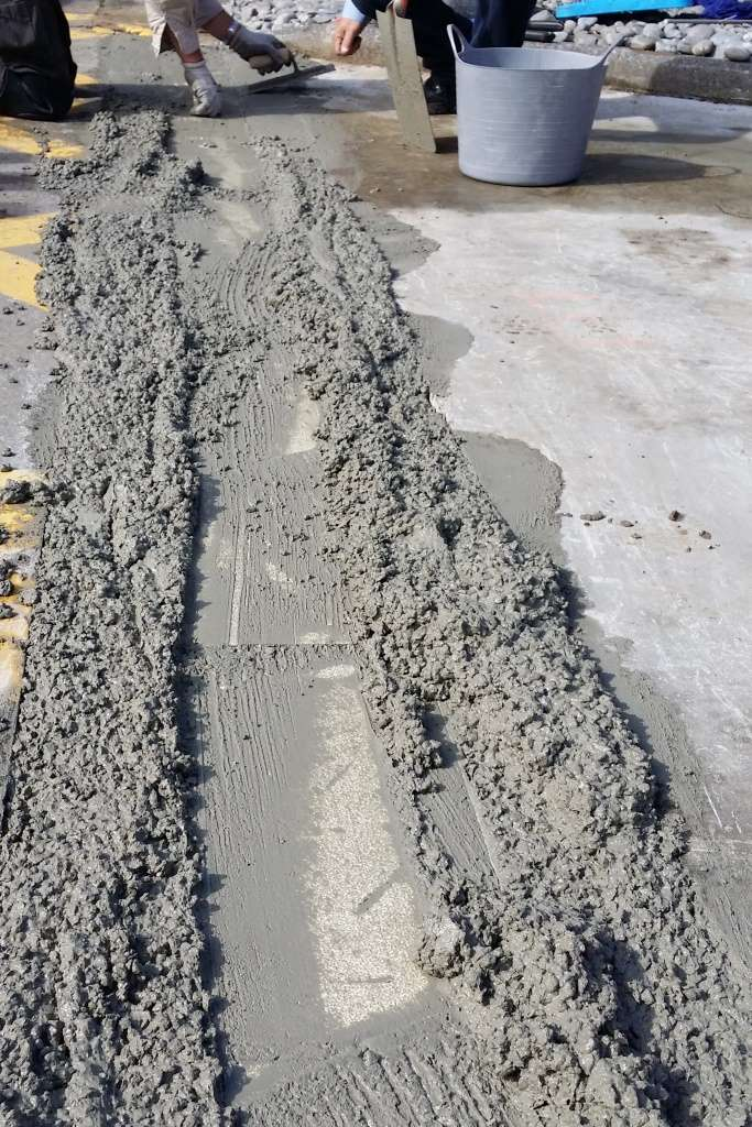 Wet concrete everywhere... Note how well the poly insert prevents the ingress of concrete into the channel